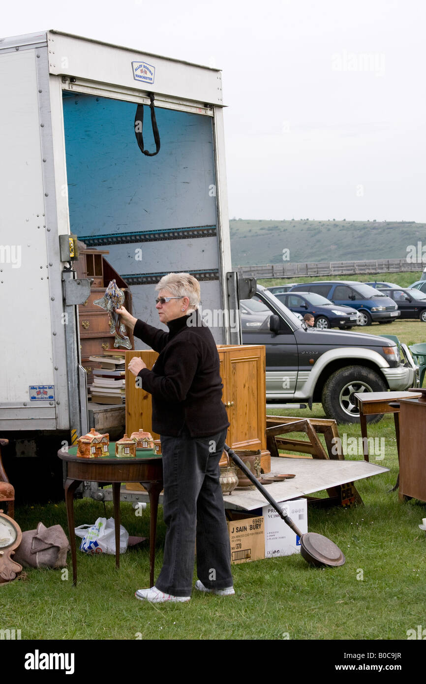 Lady browsing at a car boot sale Sussex England - Stock Image
