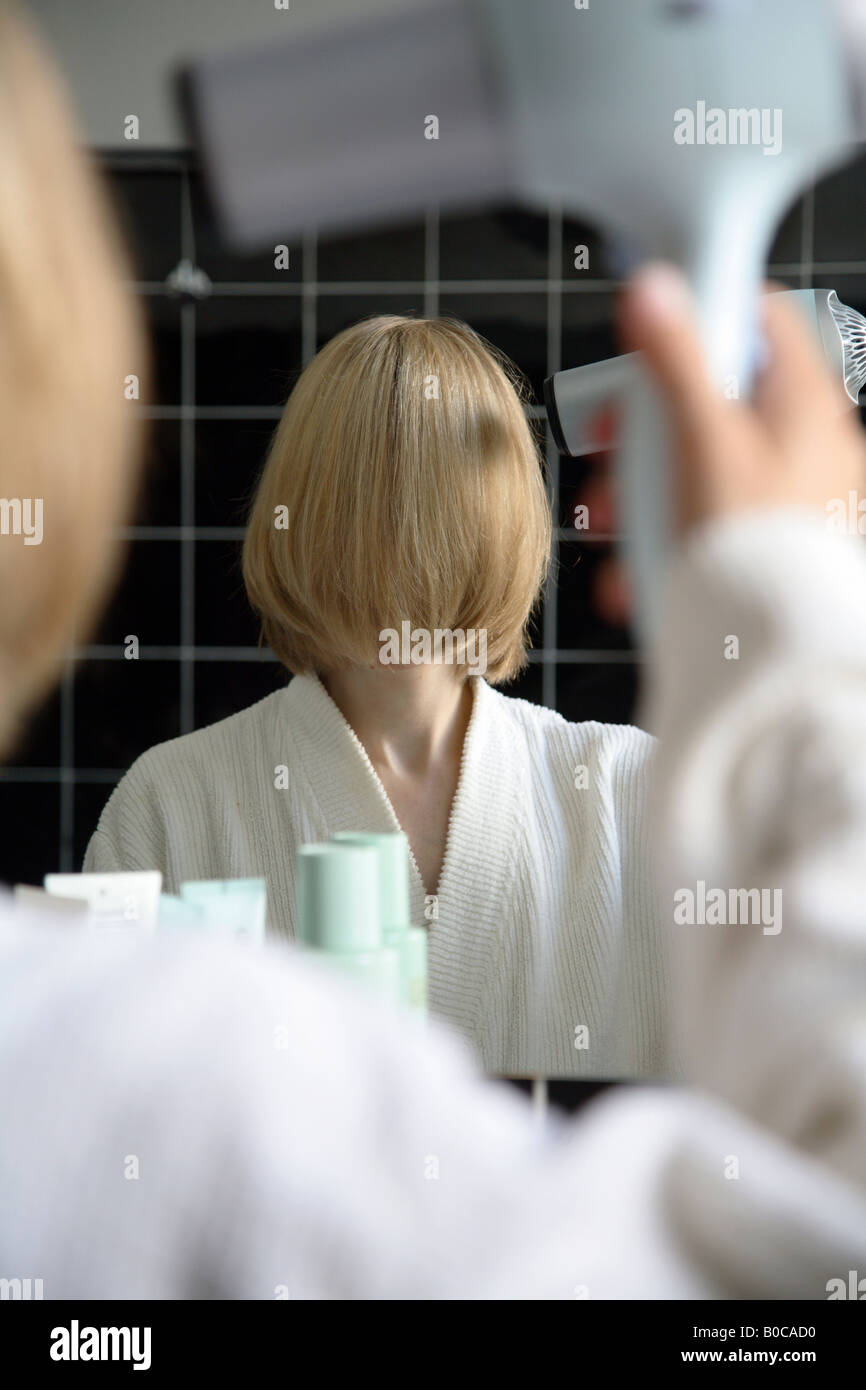 Woman in a bathroom - Stock Image