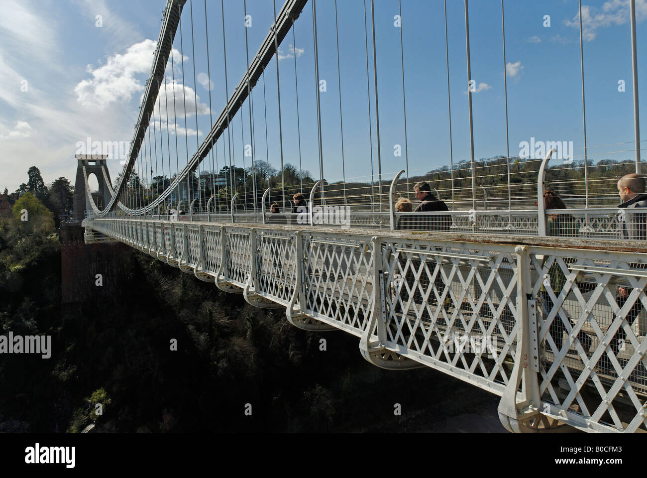 People crossing the Clifton Suspension Bridge on foot - Stock Image