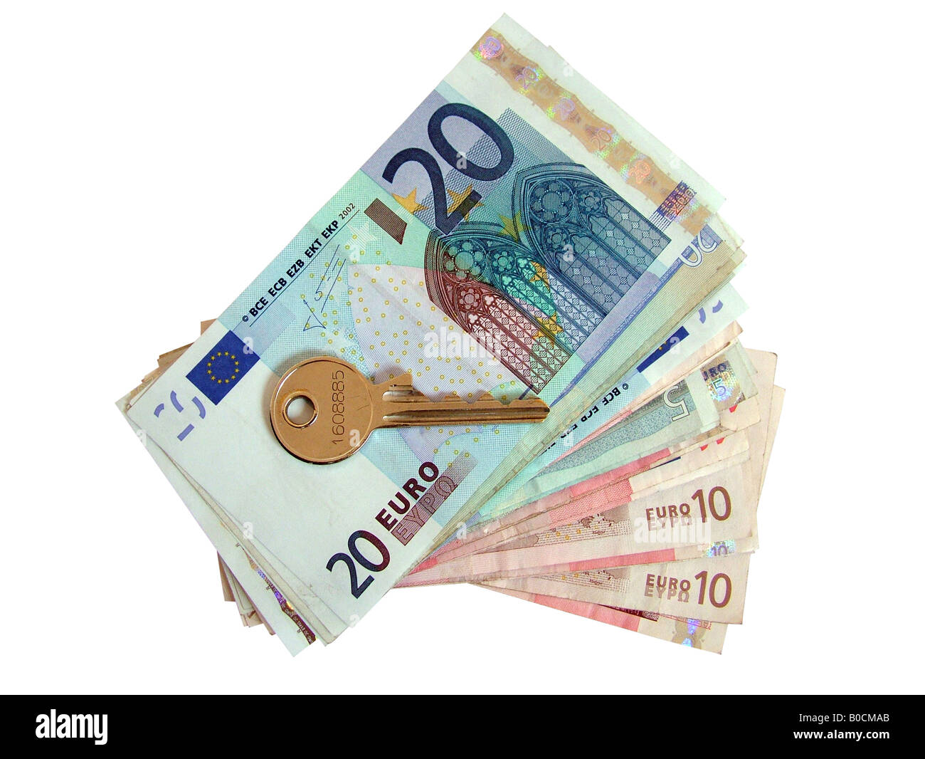 Euros and house door key Stock Photo