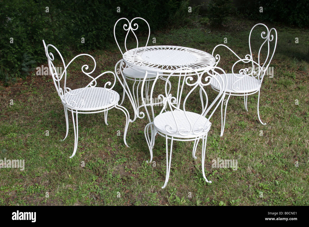 White wrought iron dining table and chairs in garden & White wrought iron dining table and chairs in garden Stock Photo ...