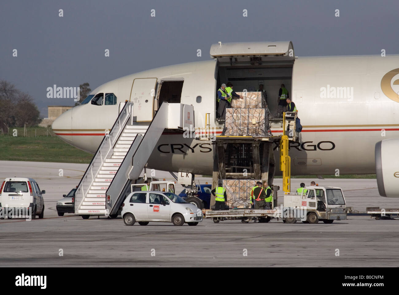 Commercial air freight transport logistics. Loading an Etihad Crystal Cargo Airbus A300 jet plane - Stock Image