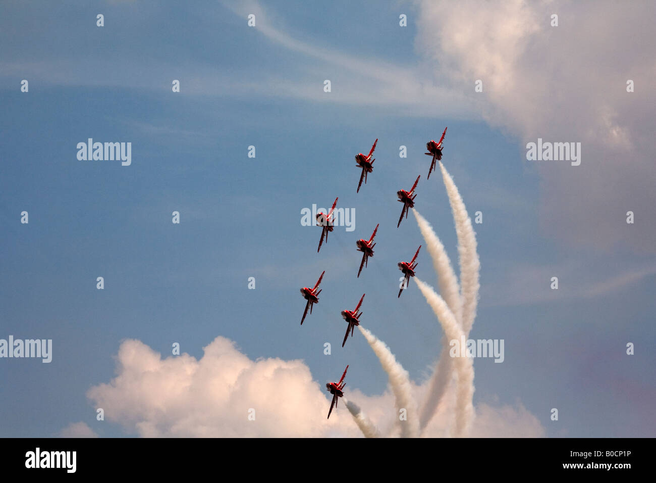 Red Arrows displaying over Wyton Air Base - Stock Image