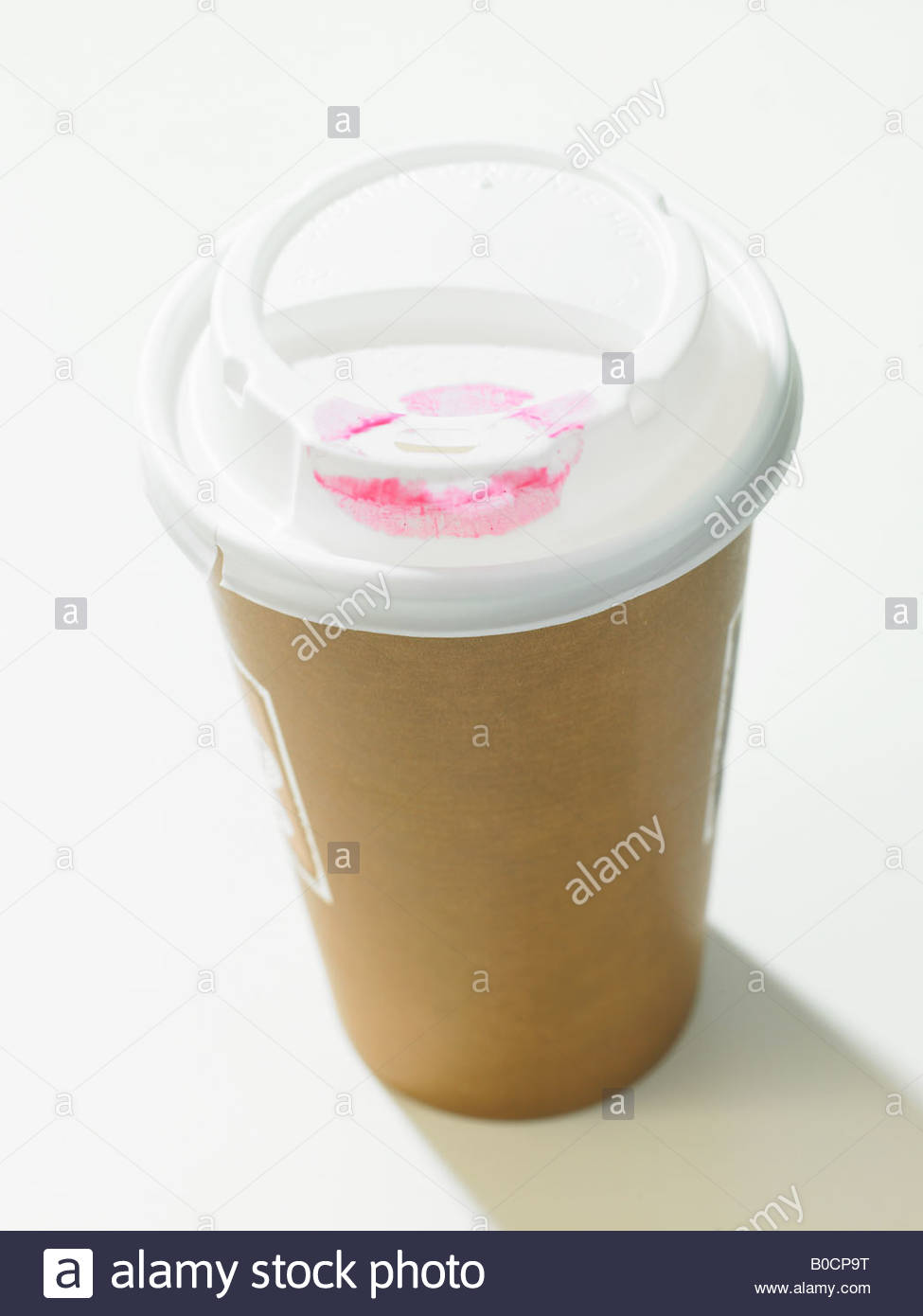 Lipstick smudge on coffee cup lid - Stock Image