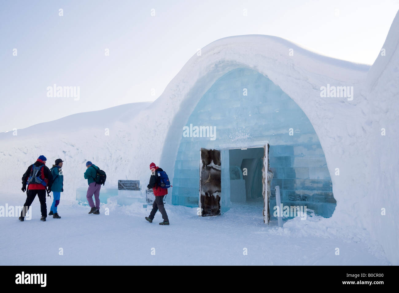Visitors in front of the Jukkasjarvi icehotel in northern Sweden - Stock Image
