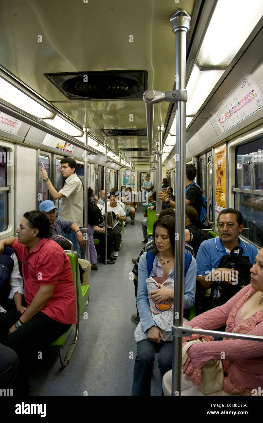 Inside busy underground train in Mexico City. - Stock Image