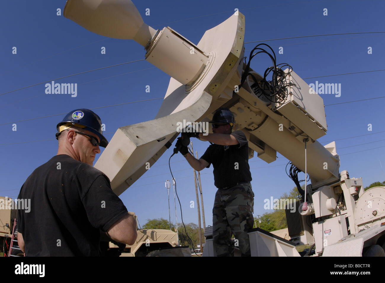 Air National Guards setup a commercial satellite antenna at the Beaufort Public Works Facility during emergency - Stock Image