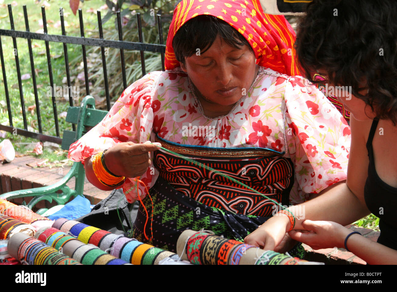 Kuna indian woman selling chaquiras at a street market of Panama City.  For Editorial Use Only. Stock Photo