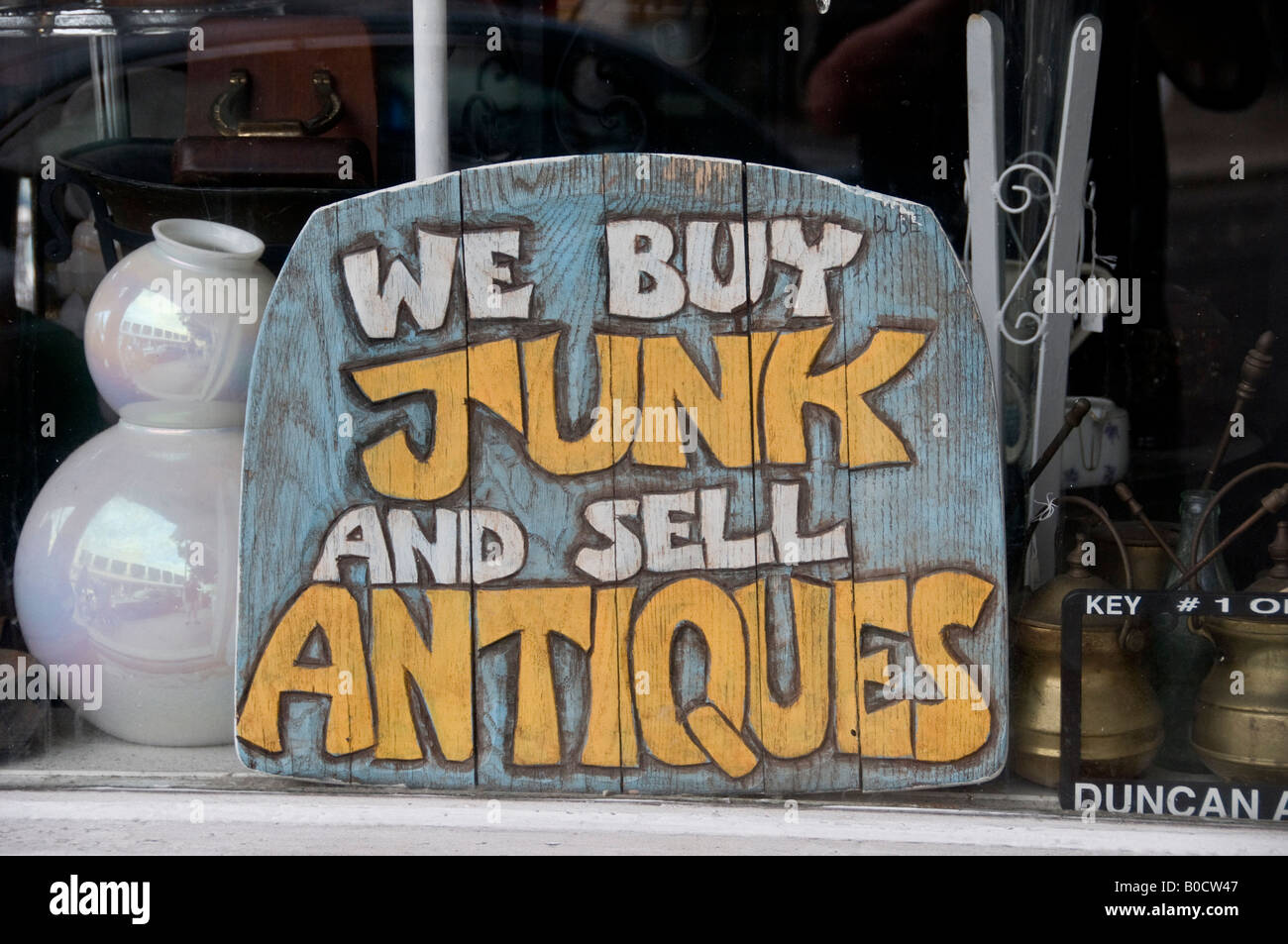 Sign in shop window in Key West Florida We buy junk and sell ...