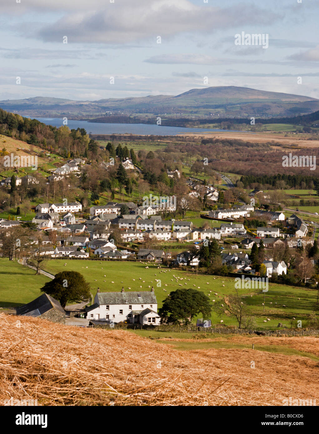 View over the village of Braithwaite and distant Bassenthwaite Lake seen from the fell above Little Braithwaite, - Stock Image