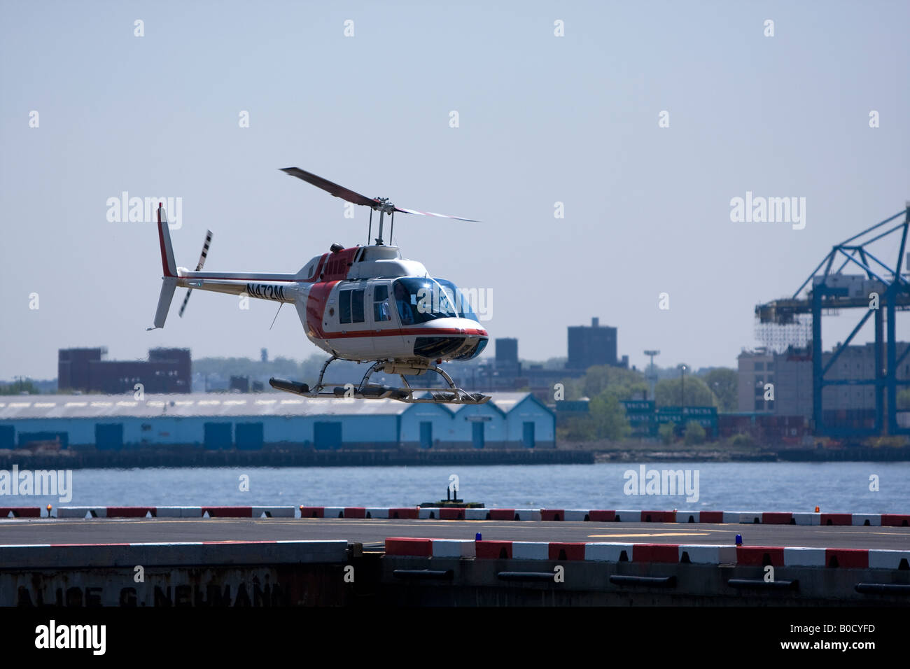 A helicopter landing at a heliport in New York City. - Stock Image