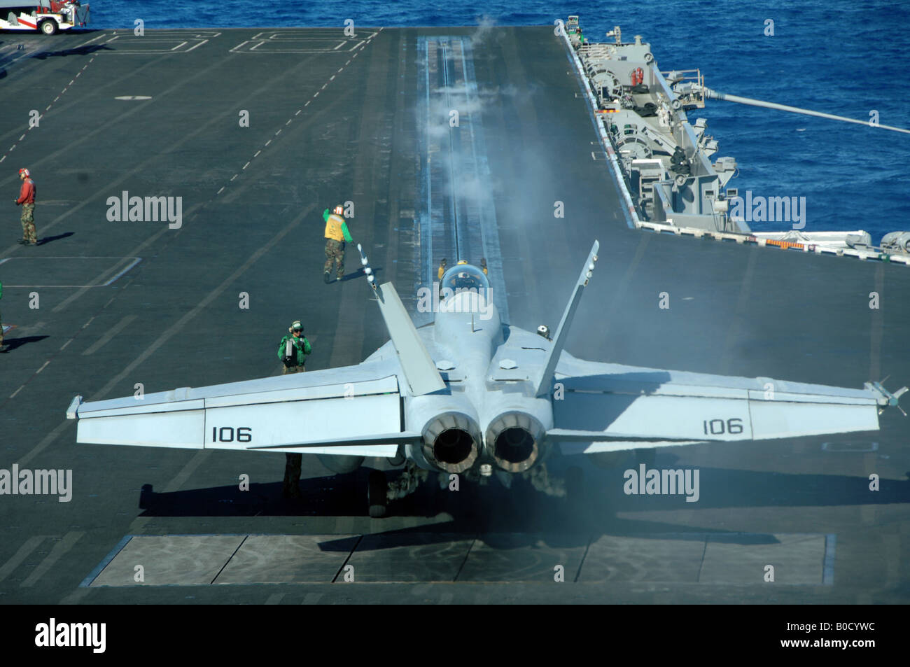 F A 18F Super Hornet aircraft prepares to launch from the flight deck of the nuclear powered aircraft carrier USS - Stock Image