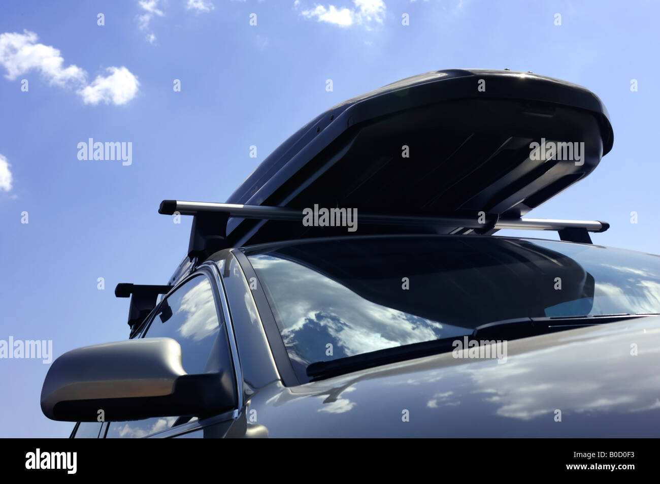 Car with a luggage box - Stock Image