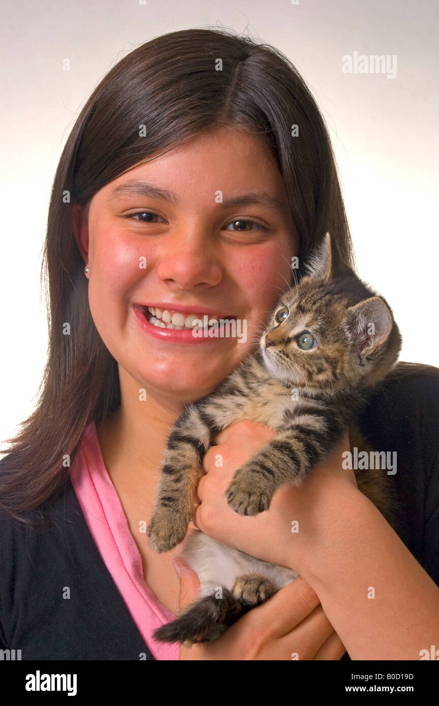 Long Haired Cute 11 Year Old Girl With Kitten Stock Photo