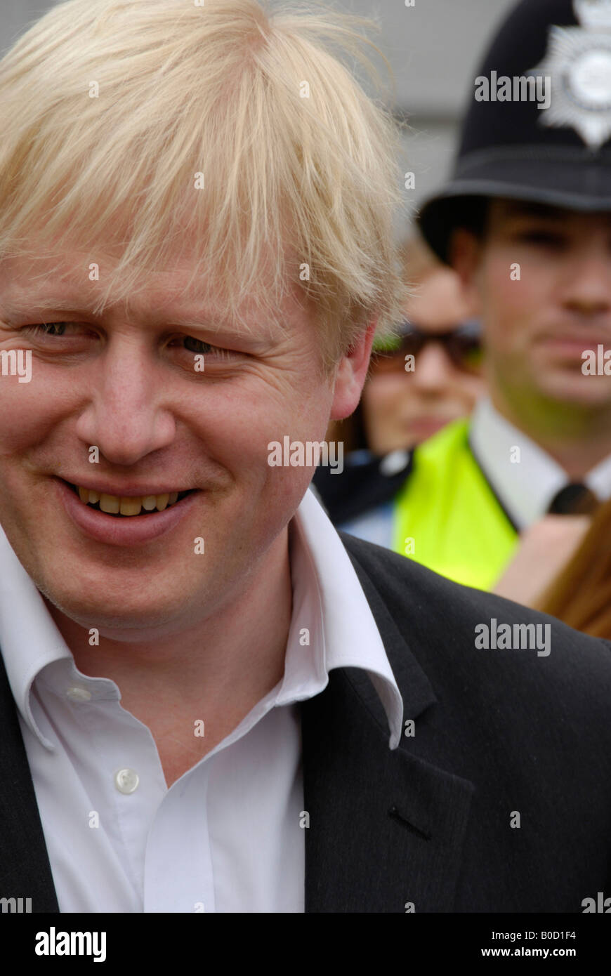 Mayor of London Boris Johnson with police constable in the background First day as mayor 5th April 2008 - Stock Image