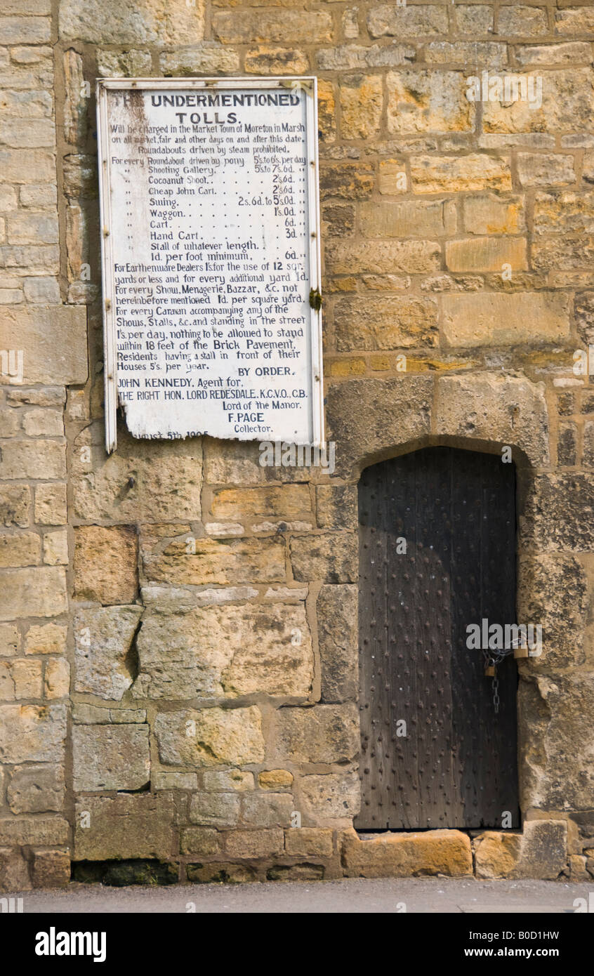 Old tolls board for weekly market in Moreton in Marsh Cotswolds Gloucestershire England UK EU - Stock Image