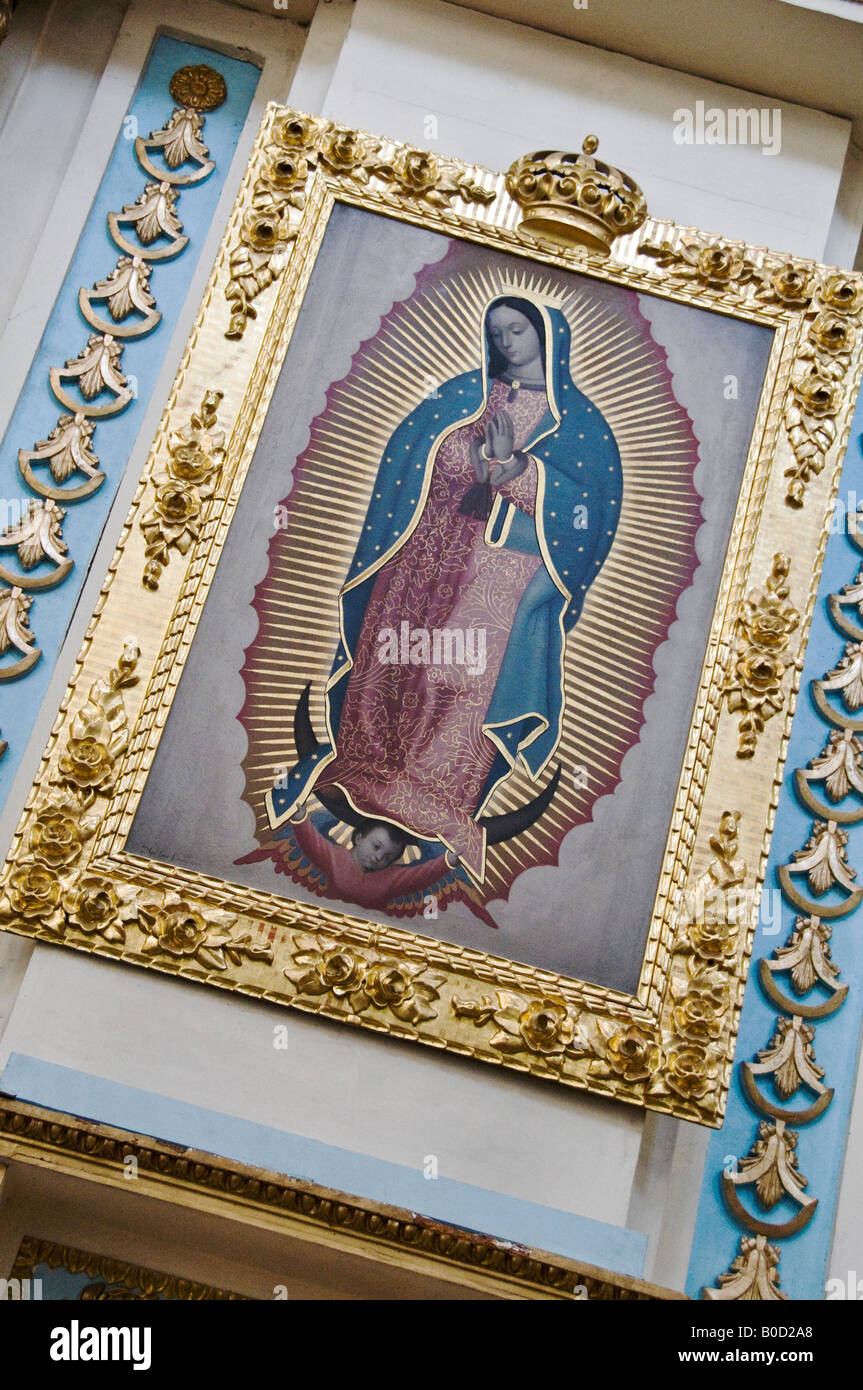 Framed print of the revered Virgin of Guadalupe at the INMACULADA CONCEPCION (immaculate conception) church in Puebla, - Stock Image