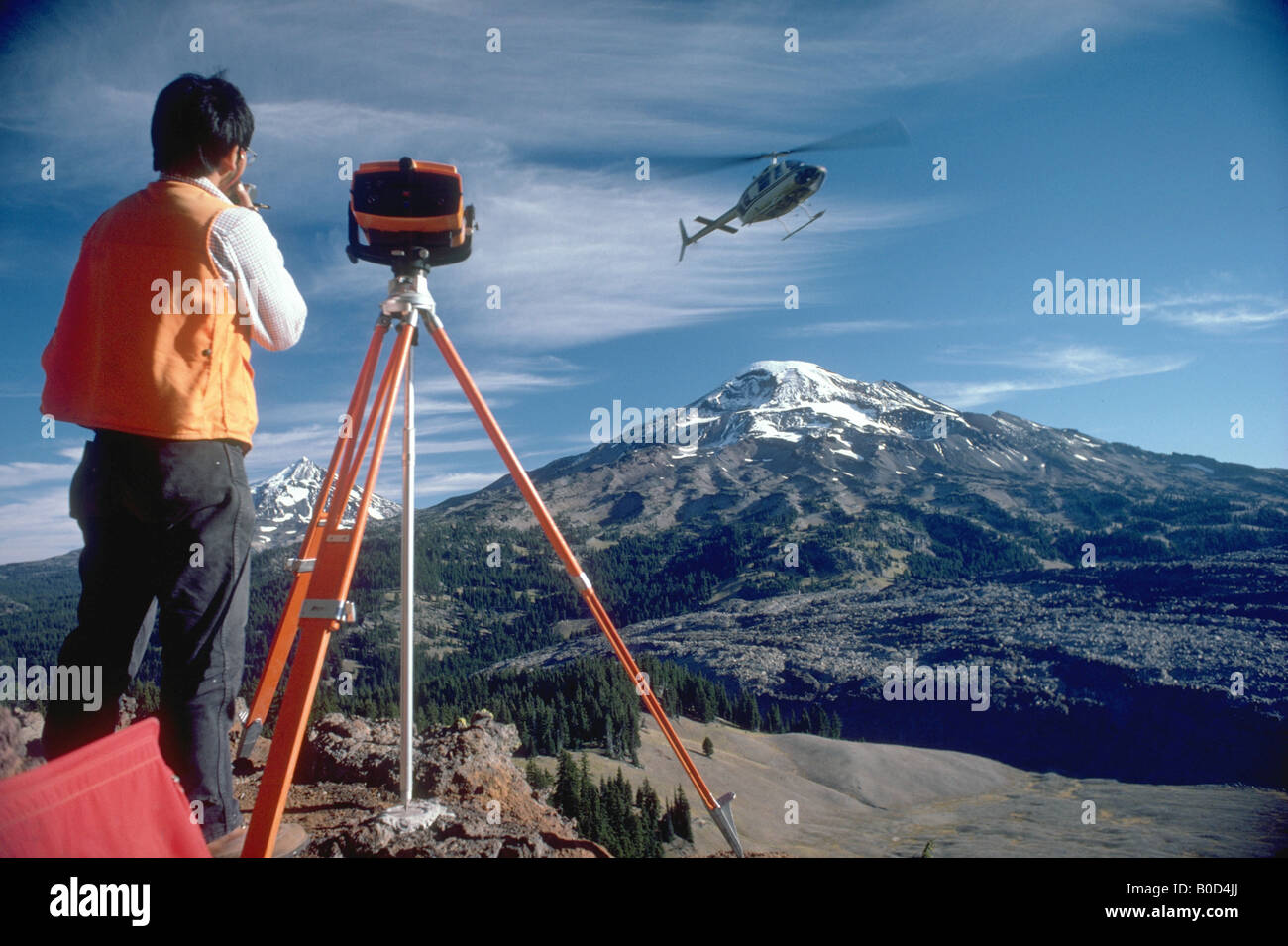 USGS Scientist conducting EDM lines South Sister Volcano - Stock Image