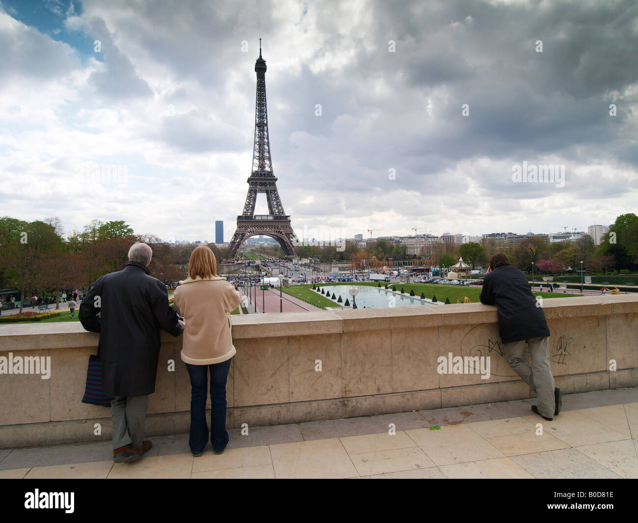 People tourists looking at the Eiffel tower from Trocadero Paris France - Stock Image