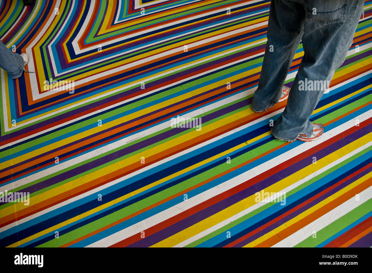 Multi colored stripes on the ground floor at Museum of Modern Art in New York - Stock Image