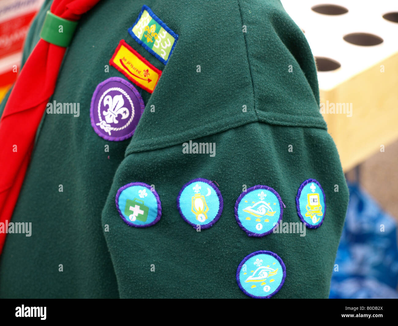 a close-up of boy scout badges and woggle. - Stock Image