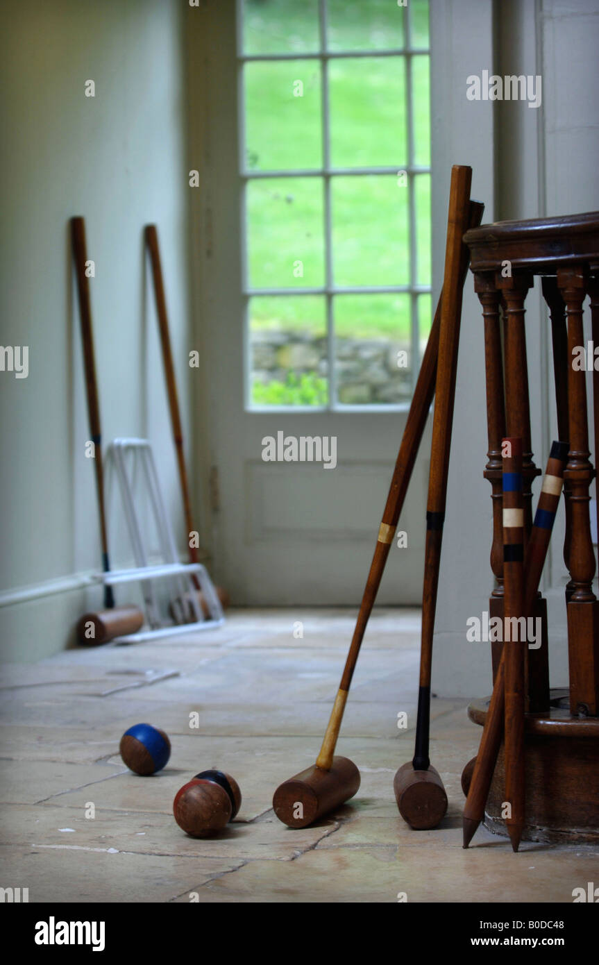 Croquet Mallets Balls And Hoops By The Back Door Of A Country House