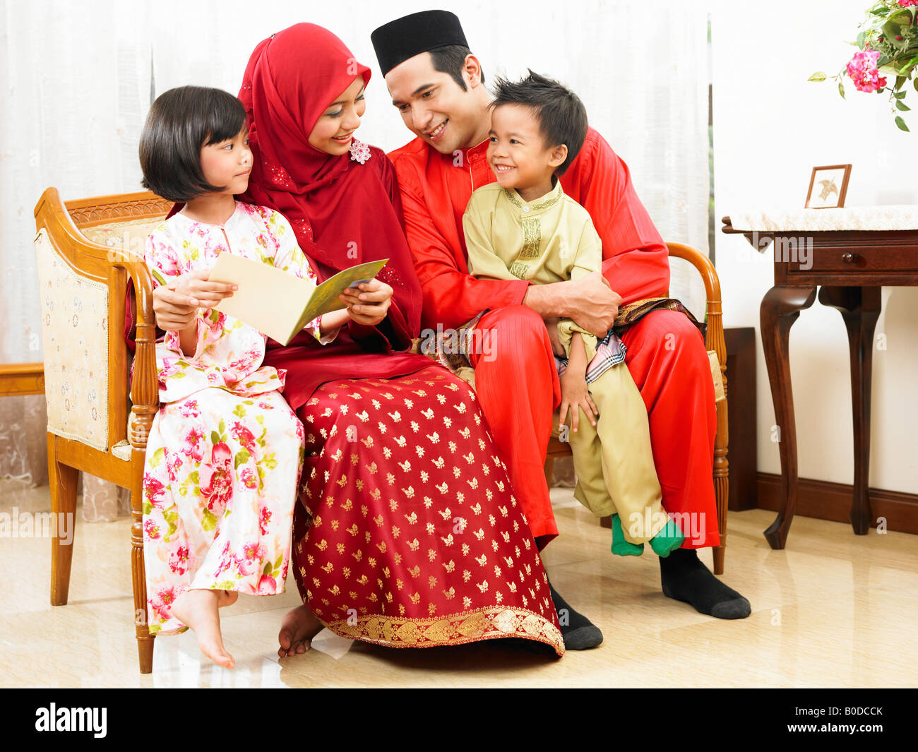 Malay Family Reading Greeting Card Laughing Stock Photo 17505507