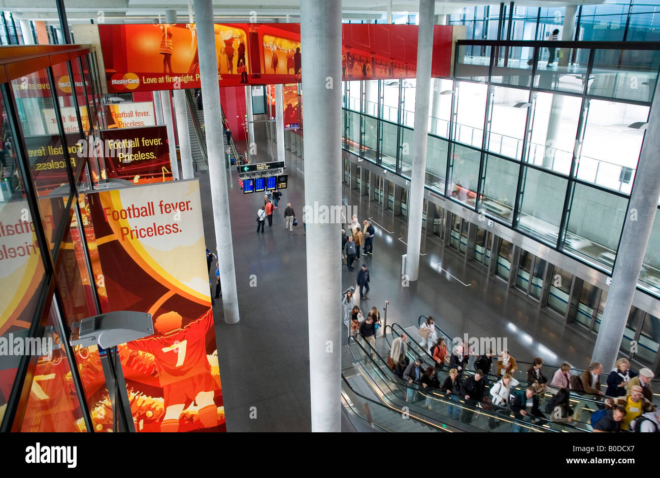 Zurich airport the Skymetro station at Terminal E passengers are going to the Gates E Advertising for the UEFA EURO - Stock Image