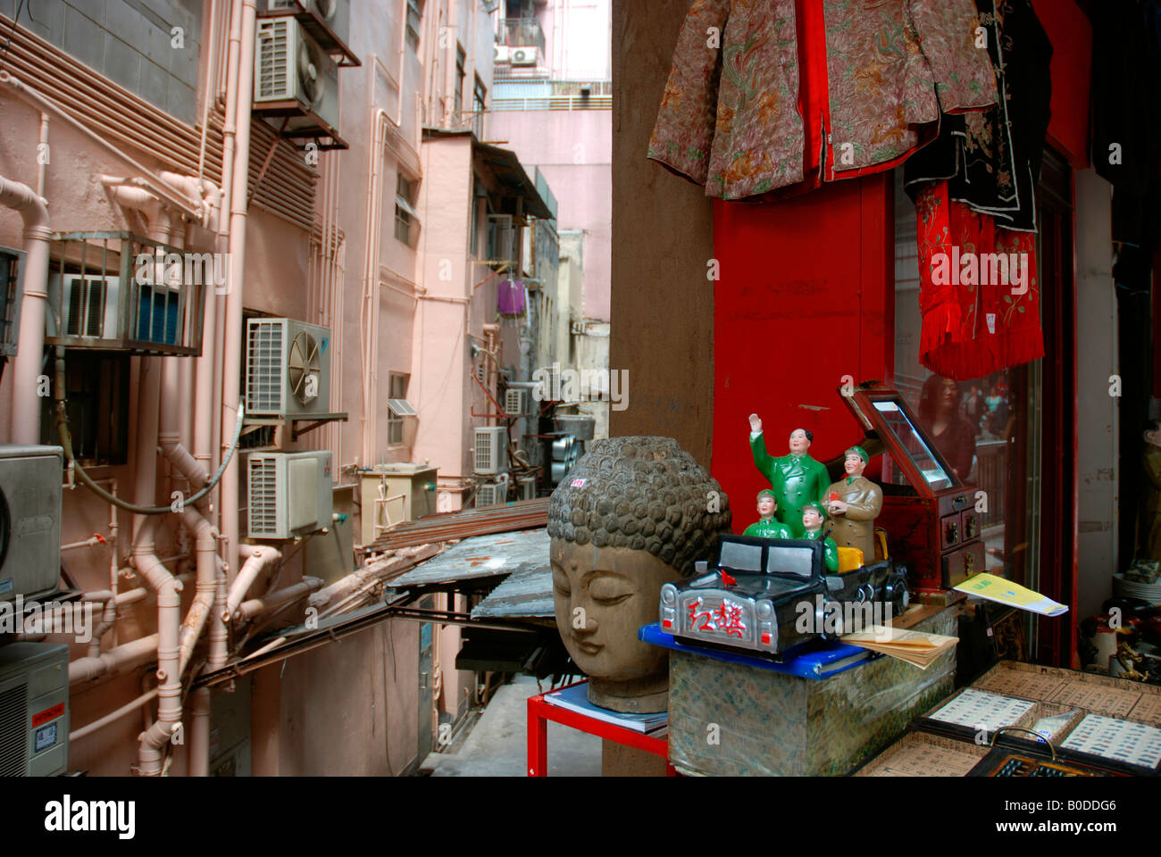 Communist memorabilia and Buddhist artifacts in an antique store in Hong Kong - Stock Image