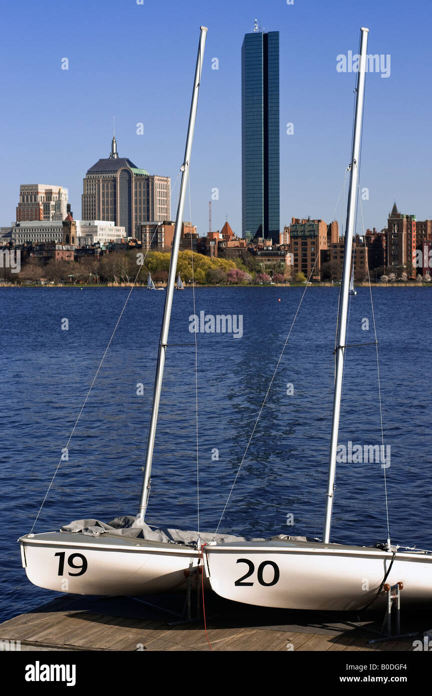 Two sailboats across the Charles river from downtown Boston. Stock Photo
