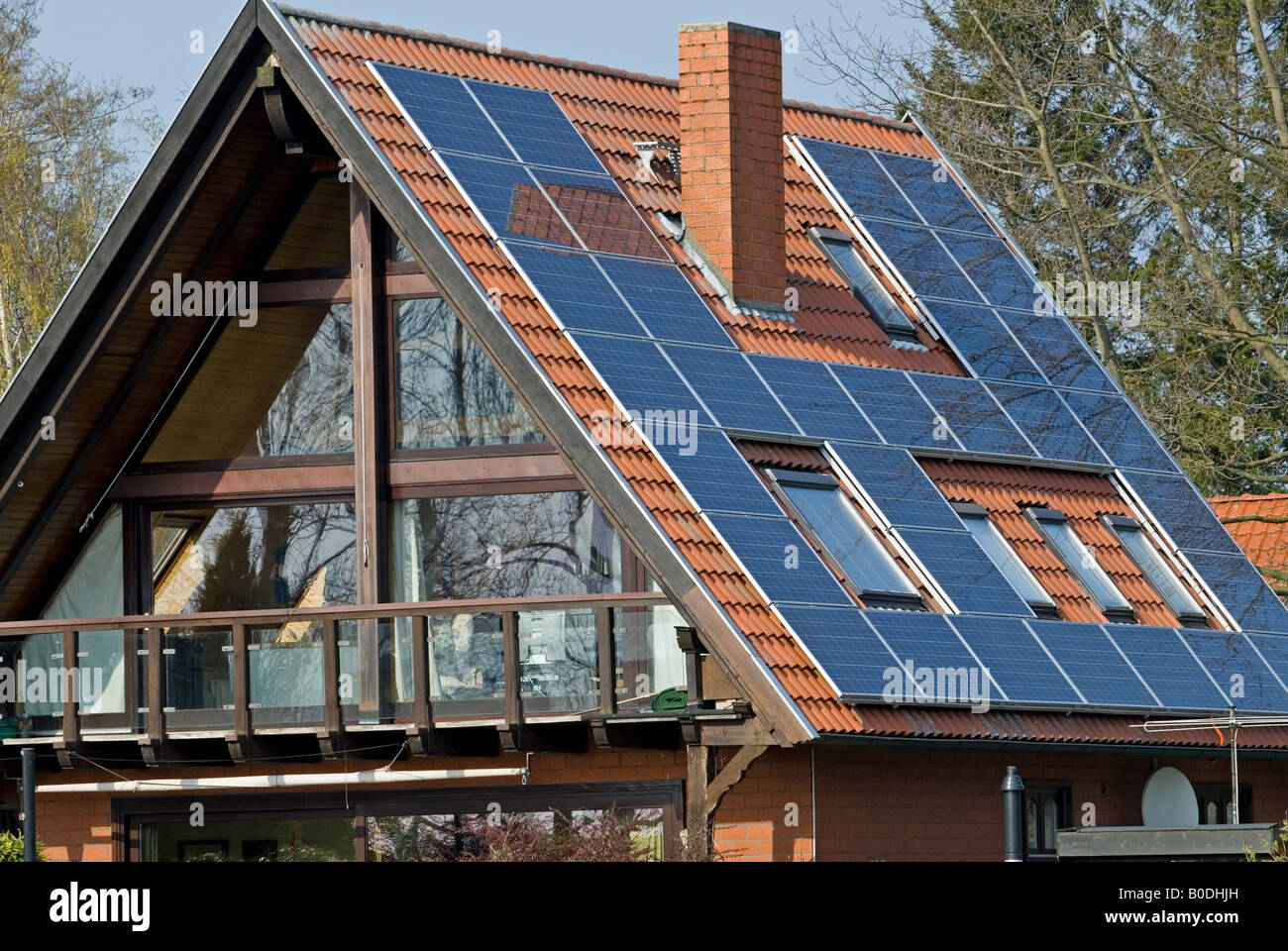 Solar panels on a residential property in Hude am Dummer, Lower Saxony, Germany. Stock Photo