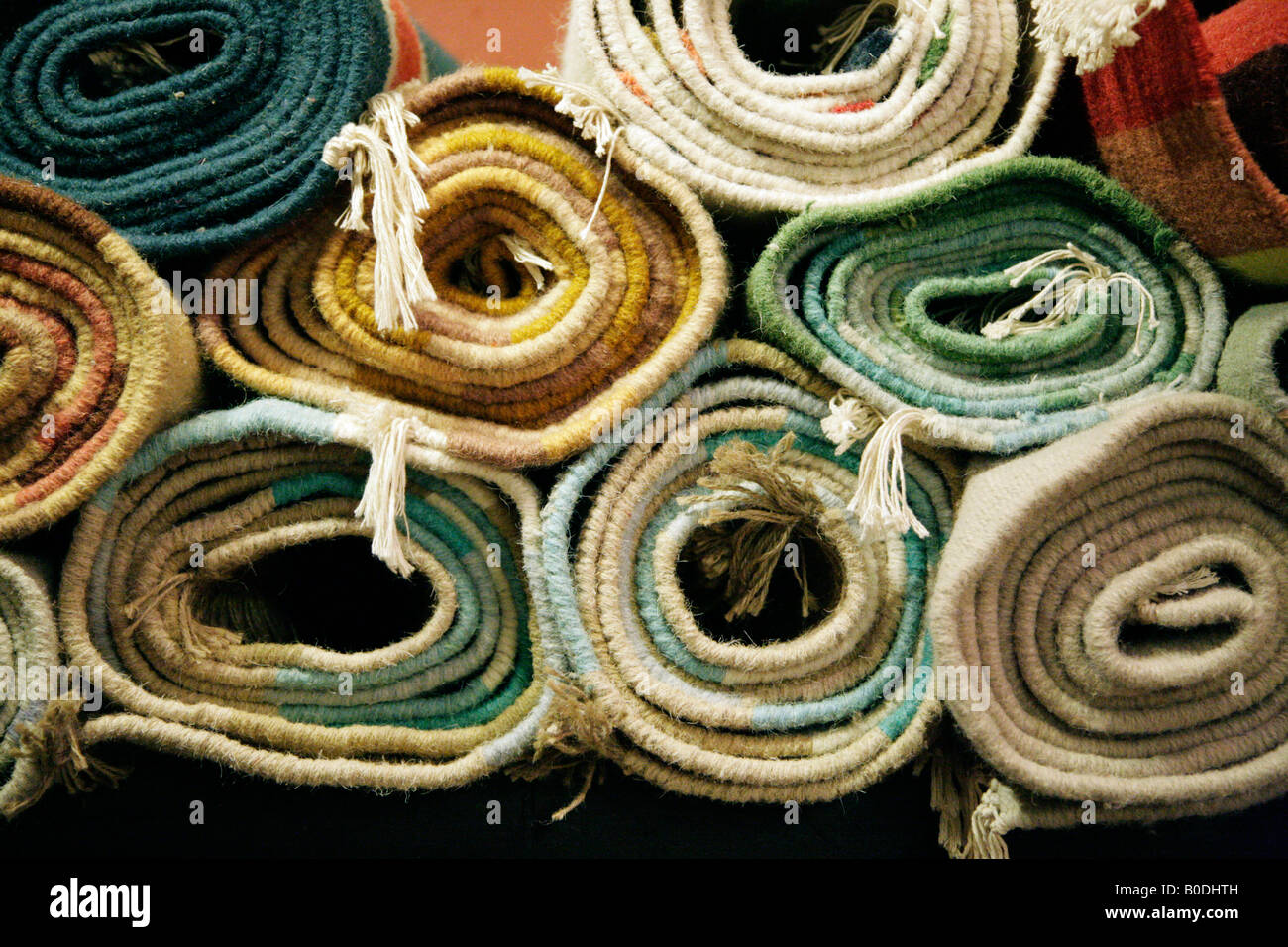 Rolled up woollen rugs - Stock Image