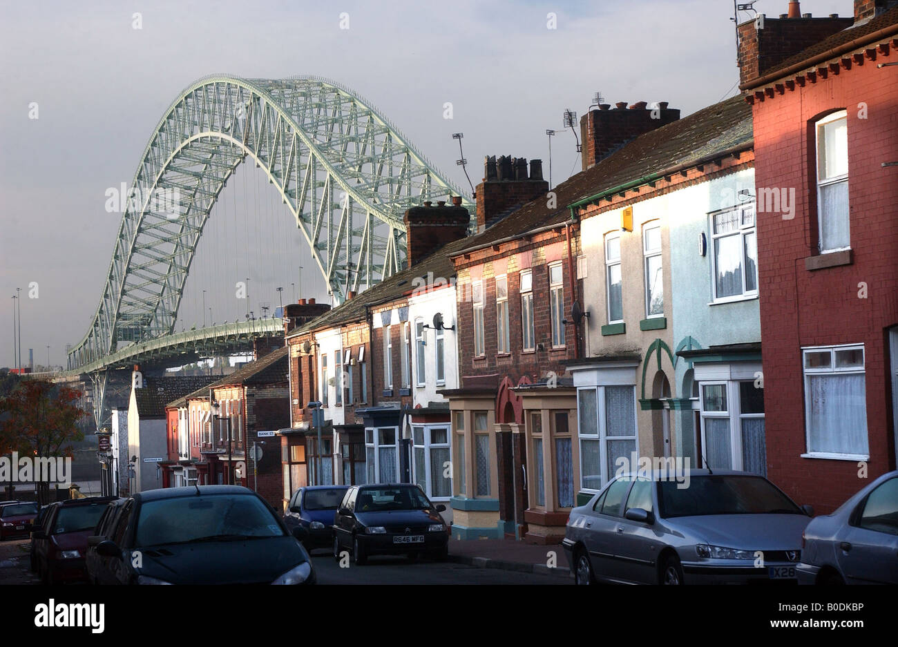 PHOTOGRAPH BY HOWARD BARLOW Terraced PROPERTY on MERSEY ROAD near to WIDNES RUNCORN BRIDGE, Cheshire - Stock Image