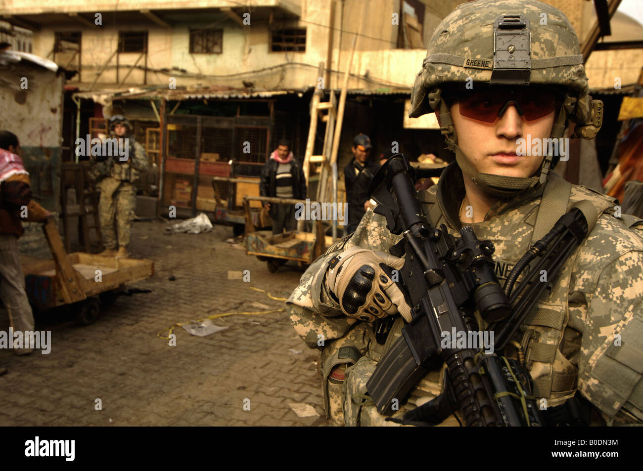US Army soldier searches for improvised explosive device caches in Rusafa Baghdad Iraq on Jan 28 2008 - Stock Image