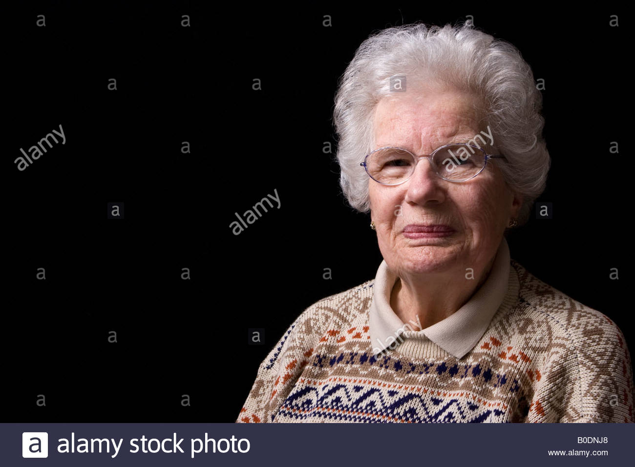 An old woman smiling. - Stock Image