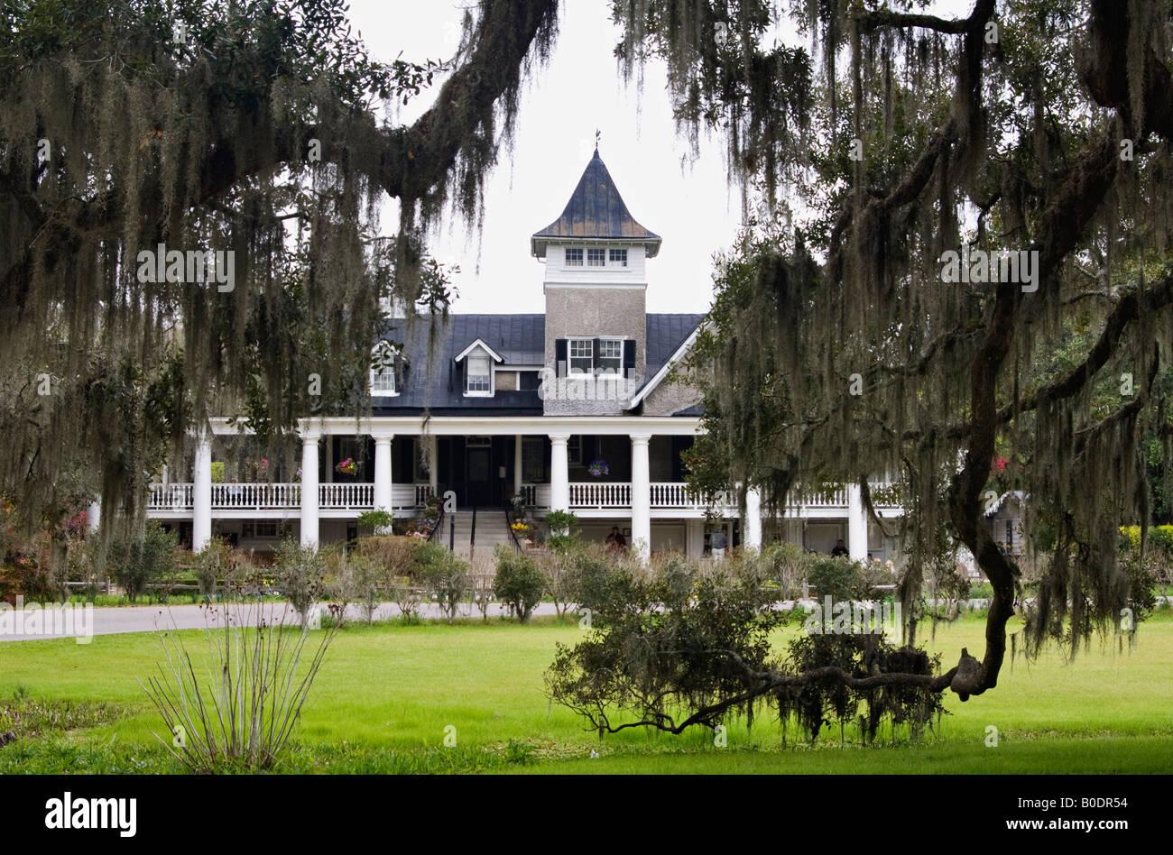 Plantation House Seen Through Live Oak And Spanish Moss At Magnolia