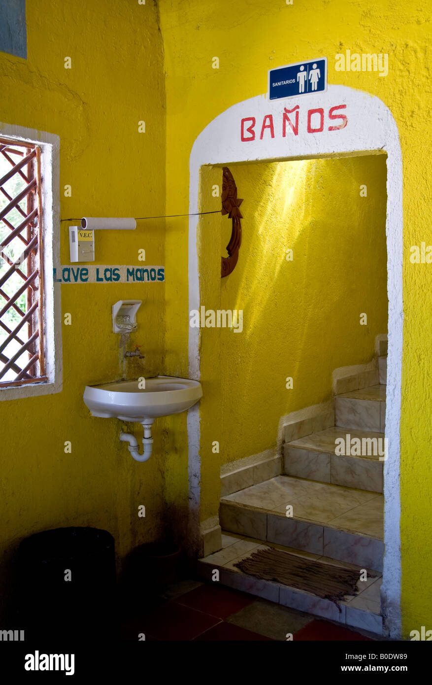 Brightly coloured yellow entrance to toilets in a cafe near the ...