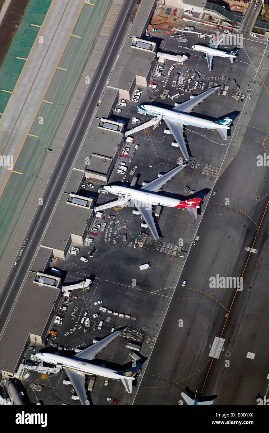 aerial above loading and unloading airliners at Los Angeles International Airport LAX, California - Stock Image