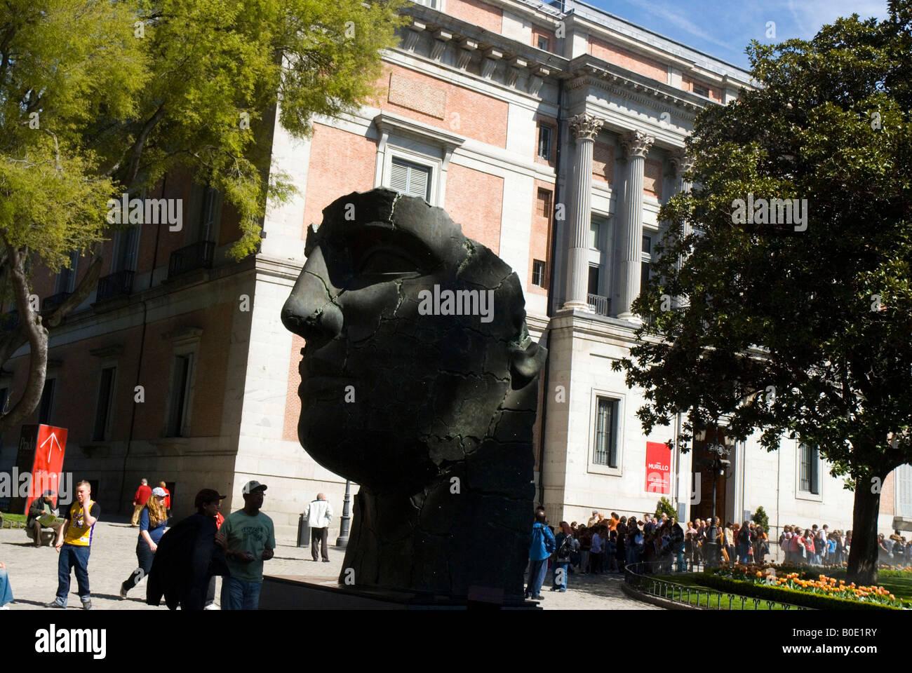 Sculpture Tindaro by Igor Mitoraj and Prado Museum in Paseo del Prado MADRID SPAIN - Stock Image