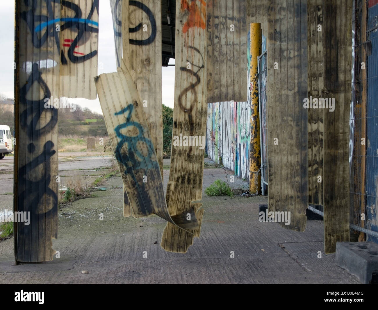 Industrial Plastic Curtains Disused Warehouse Colchester Docks Colchester Essex - Stock Image