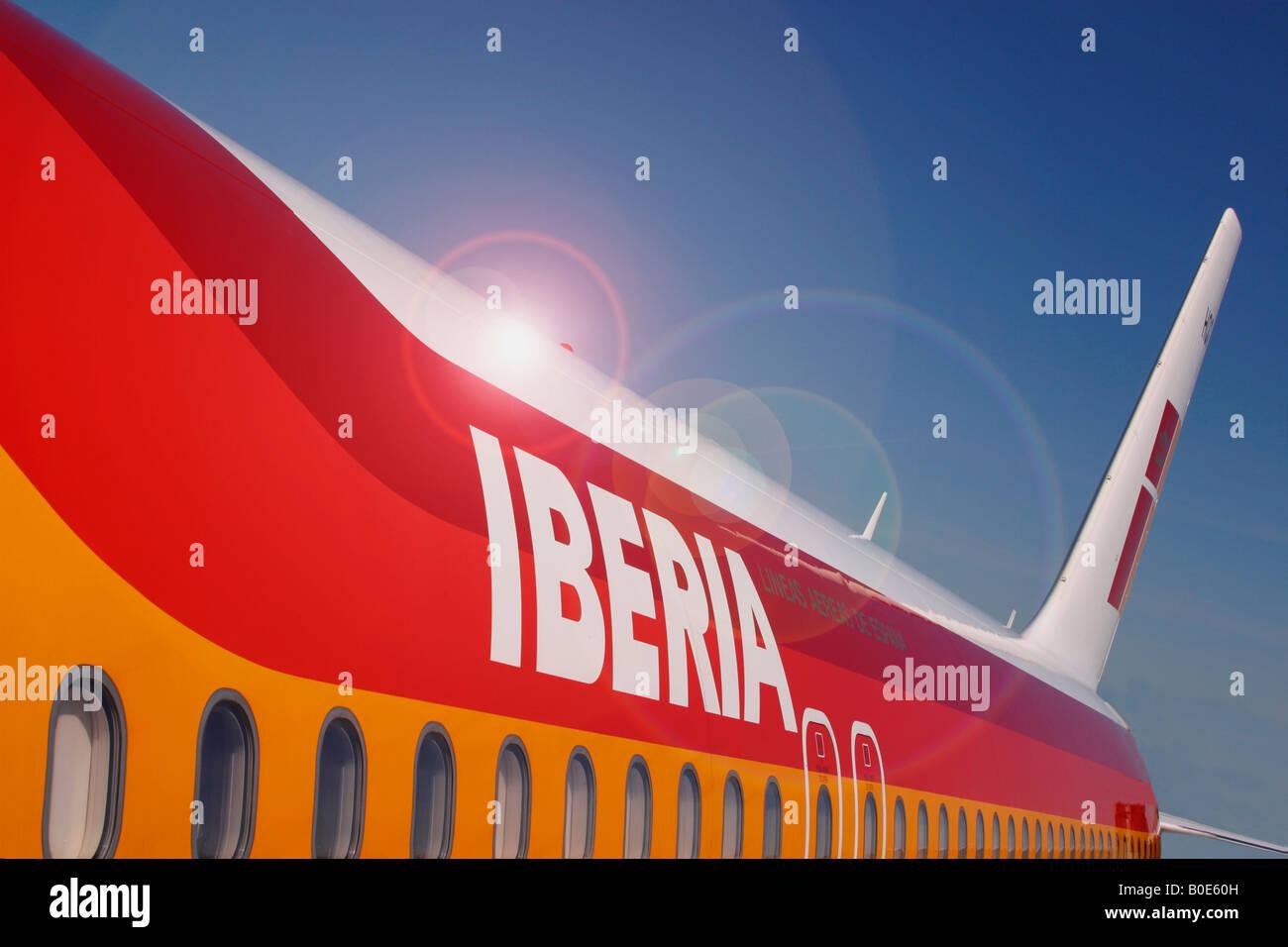 Iberia Airways jet fuselage logo at Madrid International Airport Madrid Spain Europe EU - Stock Image