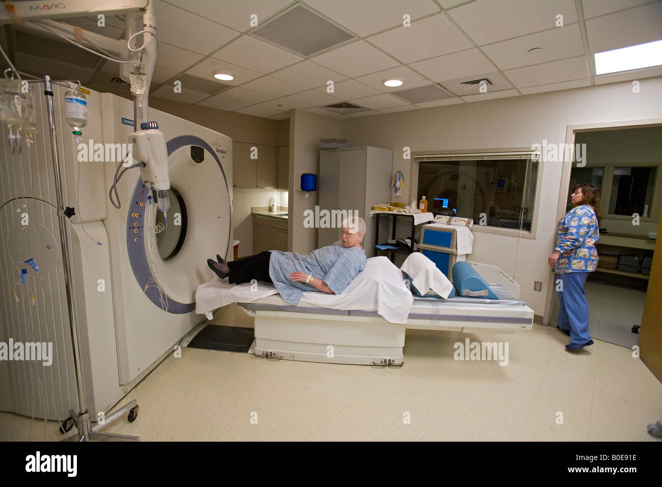 Patient gets CT scan during clinical trial of new cancer treatment - Stock Image