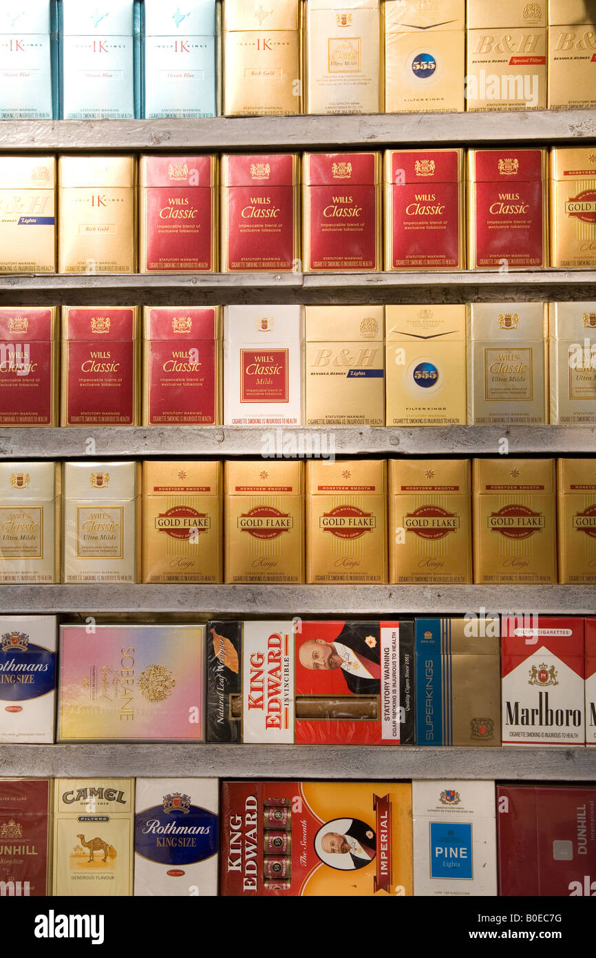 Tobacco products on sale at a tobacconists in New Delhi, India. - Stock Image