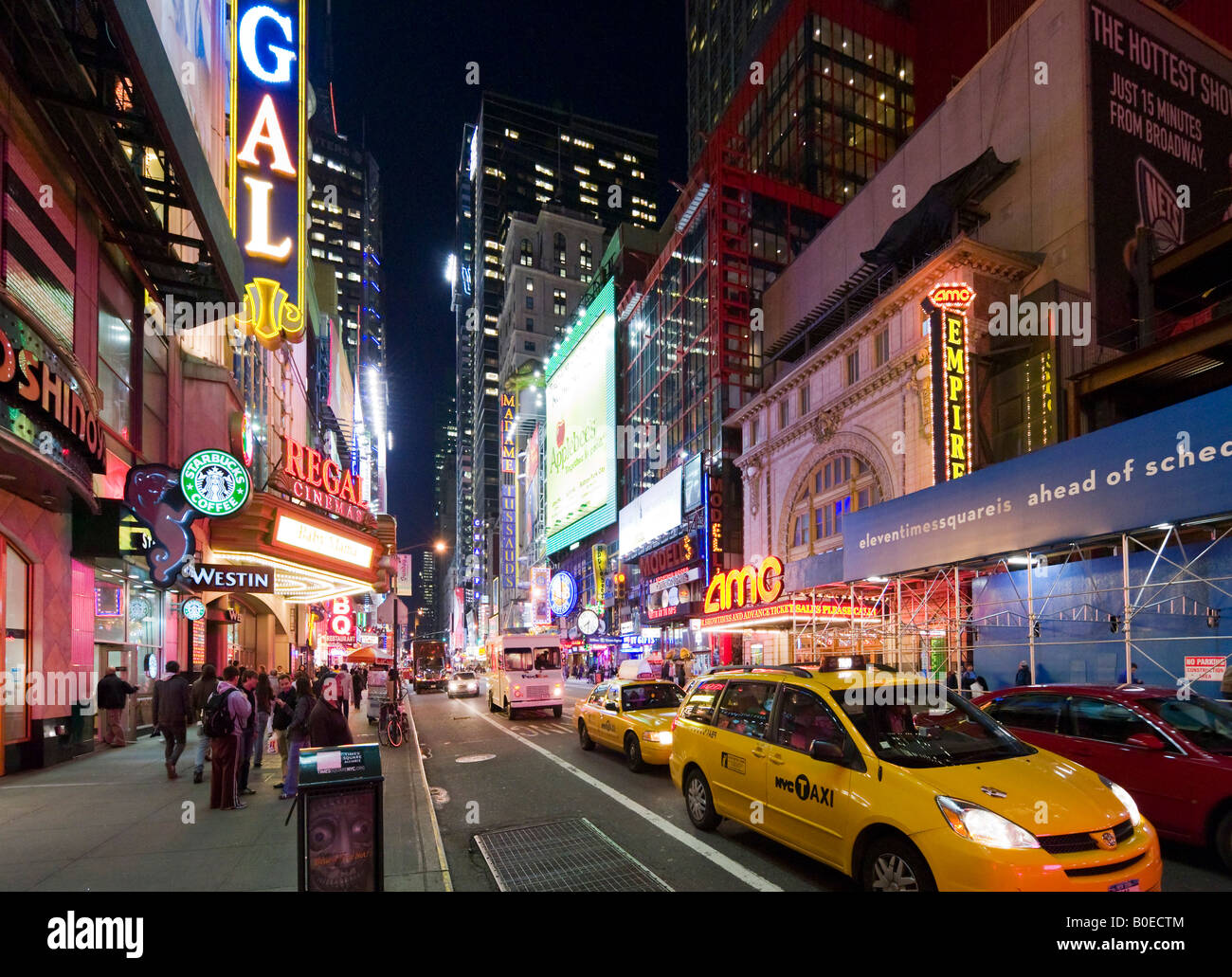 Yellow Taxi Cabs on West 42nd Street at Times Square, Manhattan, New York City - Stock Image