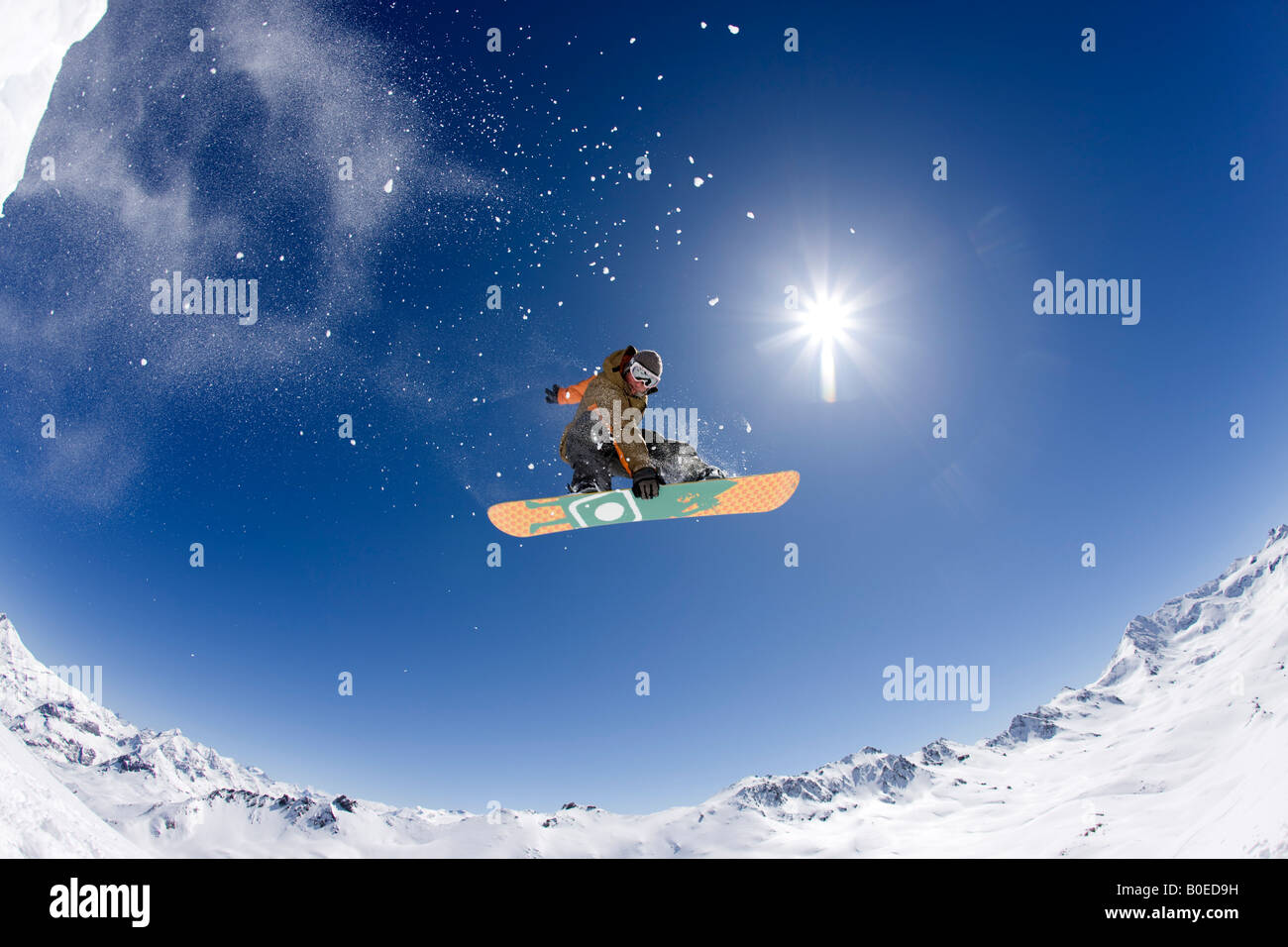 Snowboarder Clark Murray spins over the French Alps - Stock Image