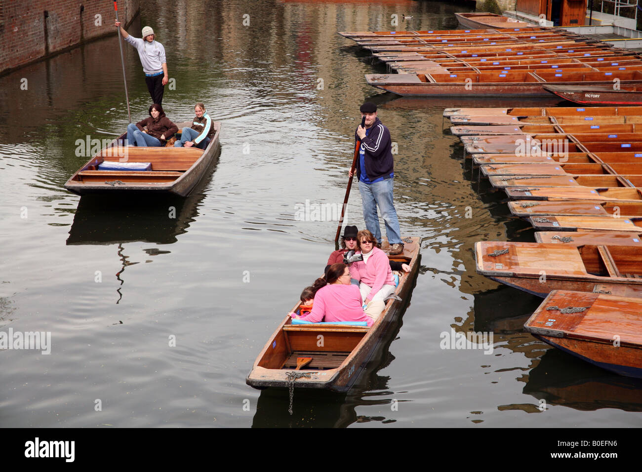 Tourists being taken on tour by punt on River Cam in Cambridge - Stock Image