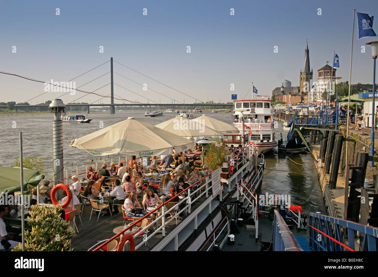 Duesseldorf Promenade at river Rhein Cafe on boats deck - Stock Image