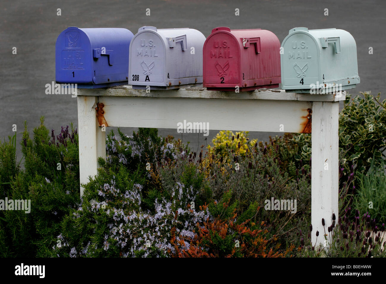 Colorful row of mailboxes - Stock Image
