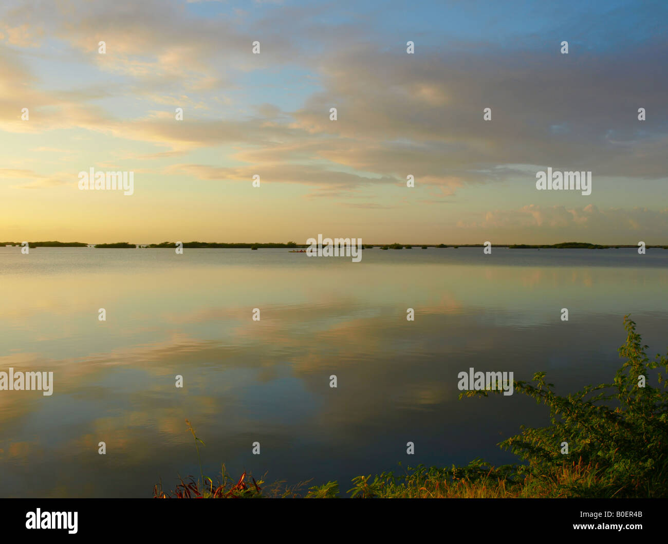 sunrise clouds reflexion over pacific ocean - Stock Image