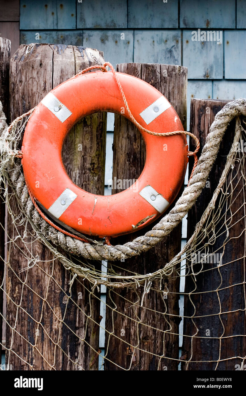 Life Ring And Fish Netting Create Outdoor Nautical Decor On